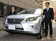 Kazuo Ohara (R), Managing Officer of Japan's Toyota Motor, introduces the new Lexus RX 450h hybrid SUV in Tokyo in April. Toyota said its net profit for the year to March 2013 was expected to more than double to $9.5 billion on continued demand in emerging markets