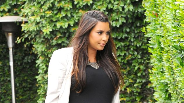 Kim Kardashian dons her trusty black maxi dress and white blazer combo the day after her baby shower. Copyright [Splash]