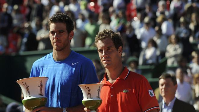Argentina's Juan Del Potro (L), Who Won, And France's Richard Gasquet (R) Pose On May 6, 2012 With Their Trophies AFP/Getty Images