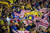 Malaysian fans celebrate victory against Indonesia in their AFF Suzuki Cup Group B match on December 1. Malaysia won the match 2-0 to reach the last four as group runners-up. They face an impressive Thailand at Kuala Lumpur's cacophonous Bukit Jalil stadium on Sunday