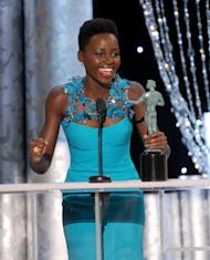 "FILE - In this Jan. 18, 2014 file photo, Lupita Nyong'o accepts the award for outstanding performance by a female actor in a supporting role for ""12 Years a Slave,"" at the 20th annual Screen Actors Guild Awards at the Shrine Auditorium, in Los Angeles. She is also nominated for an Oscar for performance by an actress in a supporting role for the film. (Photo by Frank Micelotta/Invision/AP, file)"