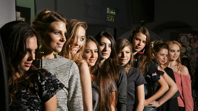 In this Tuesday, Jan. 8, 2013 photo distributed by Adi Barkan modeling agency, models stand in line for a fashion shoot in Ramat Hasharon, Israel. A new Israeli law prohibits the employment of underweight fashion models. The new law requires models to produce a medical report no older than three months at every shoot for the Israeli market, stating that they are not malnourished by World Health Organization standards.  (AP Photo/Adi Barkan modeling agency, Heftsy Elgar)