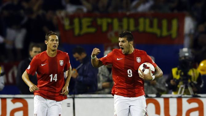 Serbia's Mitrovic celebrates with teammate Matic after scoring against Croatia during their 2014 World Cup qualifying soccer match in Belgrade