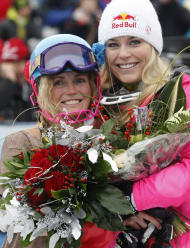 Sarah Schleper, left, poses with her teammate Lindsey Vonn, in the finish area of an alpine ski, women's World Cup slalom, in Lienz, Austria, Thursday, Dec. 29, 2011. American skier Sarah Schleper, who competed in four Winter Olympics, says Thursday's slalom will be the last World Cup race of her career. The 32-year-old Schleper will retire after 15 years and 186 races since making her World Cup debut in her native Vail, Colorado, in 1995. (AP Photo/Giovanni Auletta)