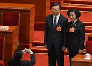 The outgoing Chinese Foreign Minister Yang Jiechi (left) poses for a photo during the 12th National People's Congress (NPC) in the Great Hall of the People in Beijing, on March 16, 2013.
