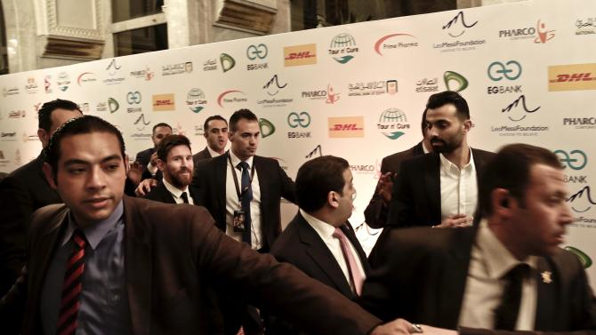 FC Barcelona's Lionel Messi, center, leaves after a gala dinner held at the Mena House in Giza, Egypt, Tuesday, Feb. 21, 2017. Soccer player Messi is in Egypt to promote the Tour n' Cure initiatives which aims to attract Hepatitis C patients from all around the world to seek treatment in Egypt. (AP Photo/Nariman El-Mofty)