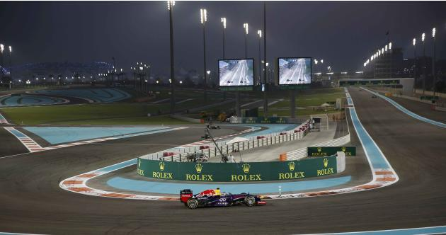 Red Bull Formula One driver Vettel of Germany takes a corner the qualifying session of the Abu Dhabi F1 Grand Prix at the Yas Marina circuit on Yas Island