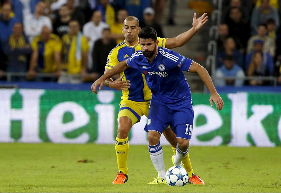 Chelsea's Diego Costa fights for the ball with Maccabi Tel Aviv's Tal Ben Haim during their Champions League Group G soccer match at Sammy Ofer stadium in Haifa