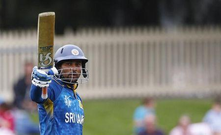 Sri Lankan batsman Dilshan acknowledges his century during the Cricket World Cup match against Scotland in Hobart
