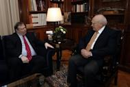 Greek Socialist Party leader Evangelos Venizelos (L) meets with Greek President Carolos Papoulias (R) in his office in Athens. Greece's president will meet political party chiefs on Sunday in a final attempt to get them to agree to a coalition after inconclusive elections that have raised fears of a Greek eurozone exit