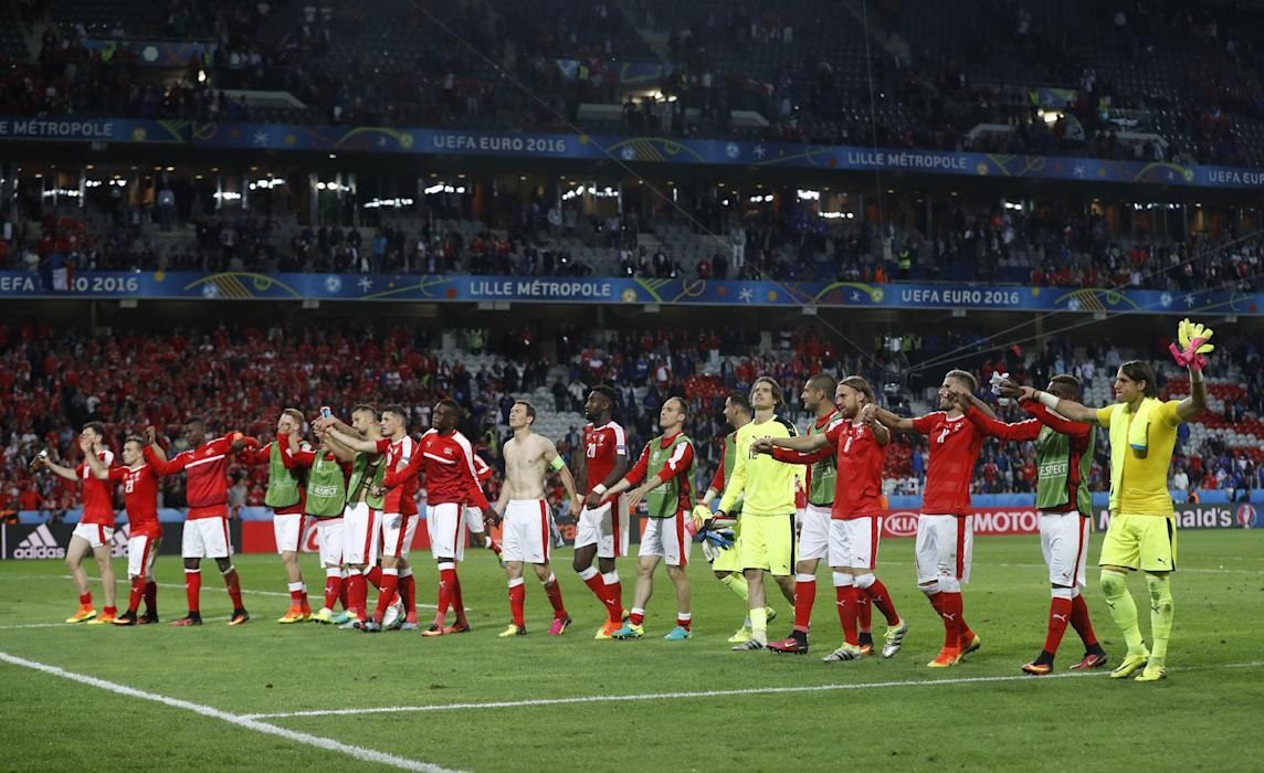 Switzerland players celebrate with fans after the game