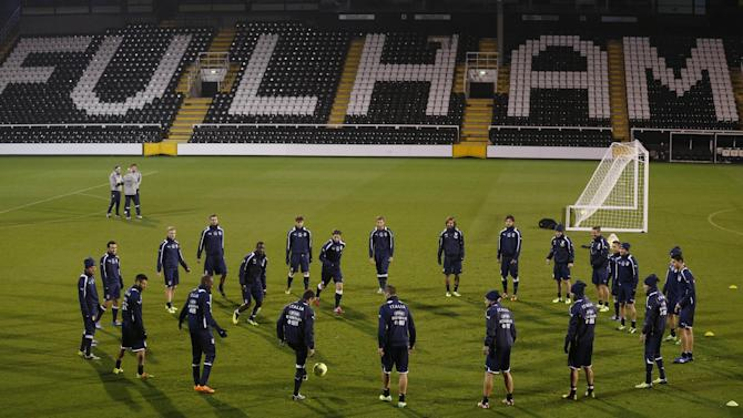 Italy's players warm-up during a training session at Craven Cottage in London, Sunday, Nov. 17, 2013. Italy is to play a friendly soccer match against Nigeria on Monday Nov. 18 at Craven Cottage in London