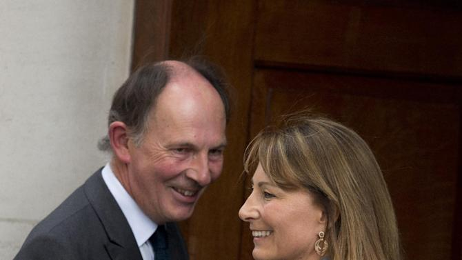 Carole Middleton, right, the mother of Kate, Duchess of Cambridge, is greeted by Jonathan Ramsey, head of the Lindo Wing, as she arrives at St. Mary's Hospital exclusive Lindo Wing in London Tuesday July 23, 2013 where the Duchess gave birth to a son on Monday July 22. The Royal couple are expected to head to London's Kensington Palace from the hospital with their newly born son, the third in line to the British throne. (AP Photo/Matt Dunham)