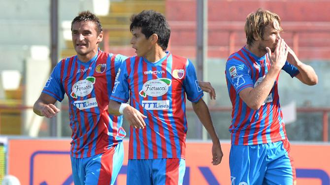 Catania's Jaroslav Plasil, of Czech Republic, right, celebrates with teammates Gonzalo Bergessio, left, and Pablo Barrientos after scoring during the Serie A soccer match between Catania and Chievo Verona at the Angelo Massimino stadium in Catania, Italy, Sunday, Sept. 29, 2013
