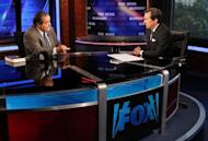 "Chris Wallace (righty) interviews U.S. Supreme Court Justice Antonin Scalia on ""FOX News Sunday"" at the FOX News D.C. bureau on July 27. Rupert Murdoch's embattled media giant News Corp -- which owns Fox News -- posted a net loss of $1.51 billion in its fiscal fourth quarter Wednesday, as the firm prepared for a major restructuring"