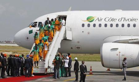The players of Ivory Coast's soccer team arrive after winning the African Nations Cup, at Felix Houphouet Boigny International airport in Abidjan