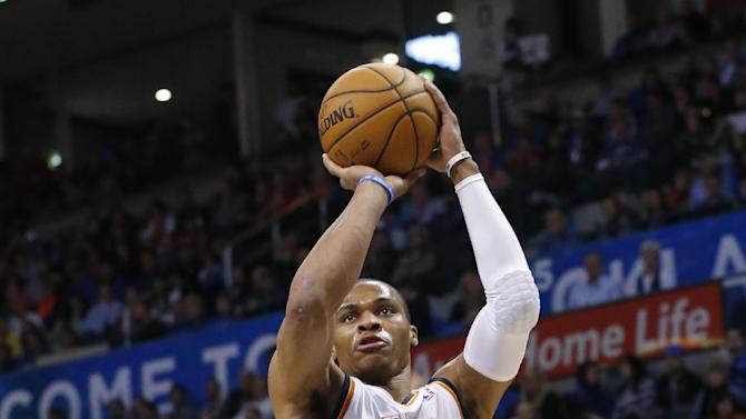 Oklahoma City Thunder guard Russell Westbrook (0) shoots over San Antonio Spurs guard Tony Parker (9) in the first quarter of an NBA basketball game in Oklahoma City, Wednesday, Nov. 27, 2013