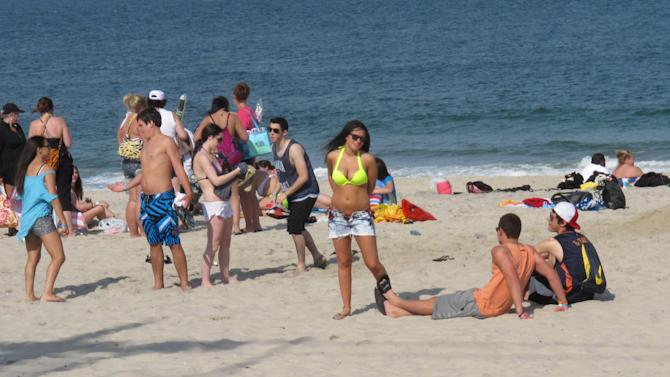 Beachgoers on the sands of Seaside Heights N.J. on June 8, 2012. New Jersey's Top Ten beaches contest is suspending voting this summer on the best beach in the state, focusing instead on cooperation among regional tourism leaders to promote the shore as a whole as it recovers from the storm. (AP Photo/Wayne Parry)