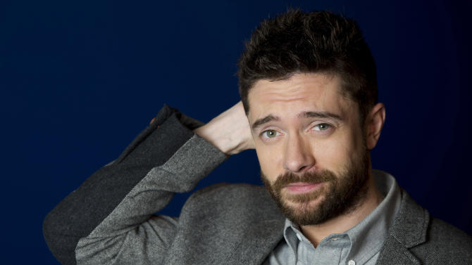 """In this April 16, 2012 photo, actor Topher Grace poses for a portrait in New York. Grace stars in the off Broadway play """"Lonely, I'm Not"""" and in an independent film called """"The Giant Mechanical Man."""" (AP Photo/Charles Sykes)"""