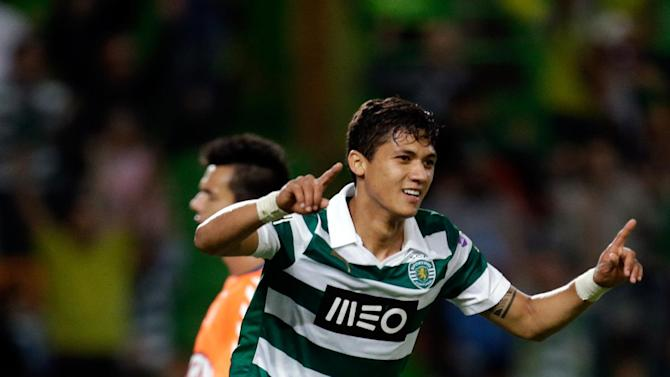 Sporting's Montero, from Colombia,  celebrates after scoring his second goal against Setubal  during their Portuguese league soccer match Saturday, Oct. 5 2013, at Sporting's Alvalade stadium in Lisbon