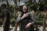 An Egyptian relative of Samir Anwar Ismail, a member of special forces who was killed in clashes between troops and anti-military protesters the previous day, mourns during his funeral in Cairo on May 5