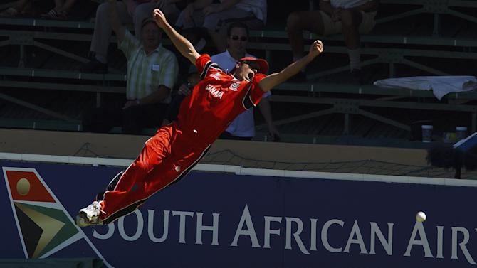 John Davison of Canada dives for a catch