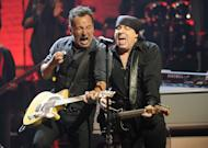 Bruce Springsteen, left, and Steven Van Zandt of the E Street Band perform at the Apollo Theater on Friday, March 9, 2012, in New York. The concert was hosted by SiriusXM in celebration of 10 years of satellite radio. (AP Photo/Evan Agostini)