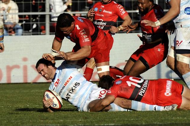 Racing-Metro's centre Jamie Roberts (L) vies with RC Toulon's players during the French Top 14 rugby union match on January 10, 2015 in Toulon, France