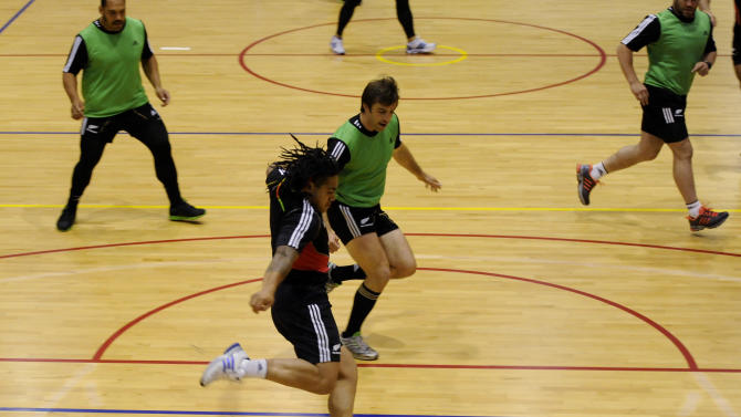 New Zealand All Blacks Ma'a Nonu kicks the ball during a game of indoor soccer at a training session in Auckland, New Zealand, Tuesday Oct 18, 2011. New Zealand play France in the Rugby World Cup final in Auckland, New Zealand Sunday Oct 23.    (AP Photo/Ross Land)