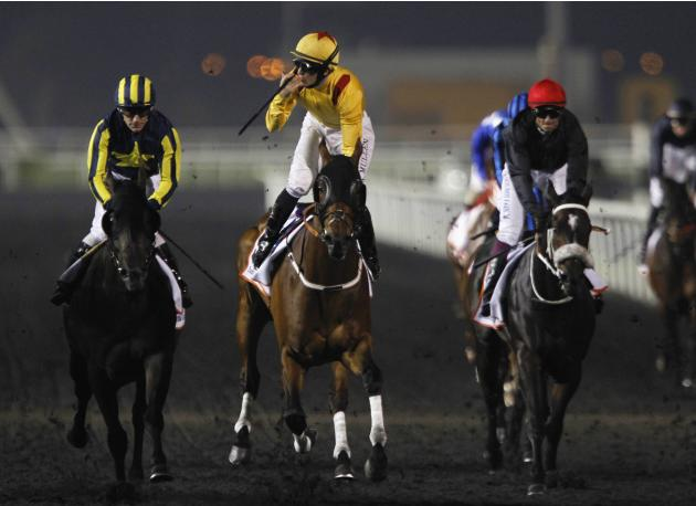 "Mullen, riding Reynaldothewizard of the U.S., blows a kiss as he crosses the finish line during the sixth race ""Dubai Golden Shaheen"" of the Dubai World Cup at the Meydan Racecourse in Dubai"