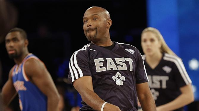 Former NBA player Tim Hardaway Sr. watches his shot during the skills competition at the NBA All Star basketball game, Saturday, Feb. 15, 2014, in New Orleans