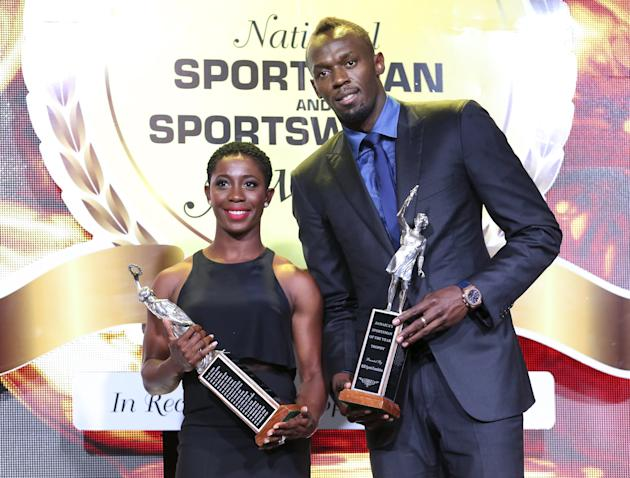 Jamaican sprinters Shelly-Ann Fraser-Pryce and Usain Bolt pose for photographs after receiving the 2015 National Sportswoman and Sportsman awards in Kingston