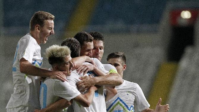 Slovenia's Josip Ilicic, center, celebrates with his teammates after he scored against Cyprus during their World Cup group E qualifying soccer match at GSP stadium in Nicosia, Cyprus, Tuesday, Sept. 10, 2013.  Slovenia won the match 2-0