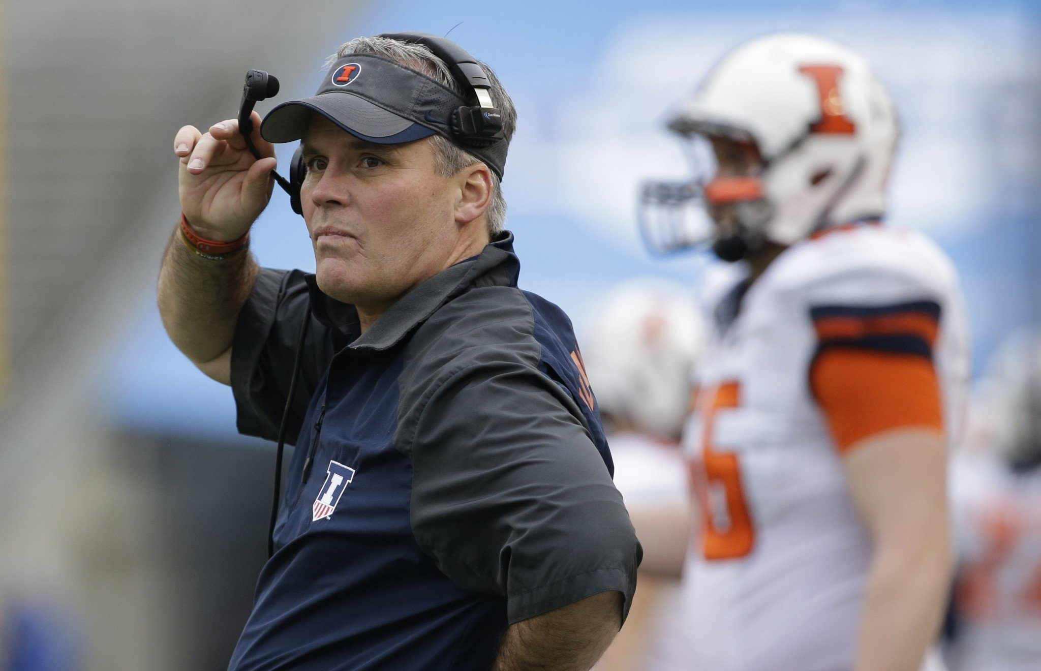 In this Dec. 26, 2014, file photo, former University of Illinois head coach Tim Beckman watches from the sidelines during an NCAA college football game in Dallas. (AP Photo/LM Otero, File)