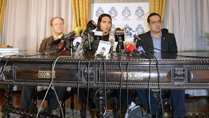 Colombian soccer star Radamel Falcao attends a press conference, with Doctors Jose Carlos Noronha, left, from Portugal and Carlos Ulloa, from Colombia, at the Trindade Hospital in Porto, Portugal, Monday, Jan. 27, 2014.  Colombia and Monaco's striker Falcao is in a race against time to get fit for the World Cup in June after undergoing knee surgery Saturday, Jan. 25, with his doctor giving him a better than 50-50 chance of making it