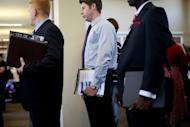 People stand in line for interviews at the Opportunity Job Fair in San Diego, California. US President Barack Obama urged members of Congress to pass a series of measures stimulating economic growth and job creation as he blasted lawmakers for failing to do so before the November 6 elections.
