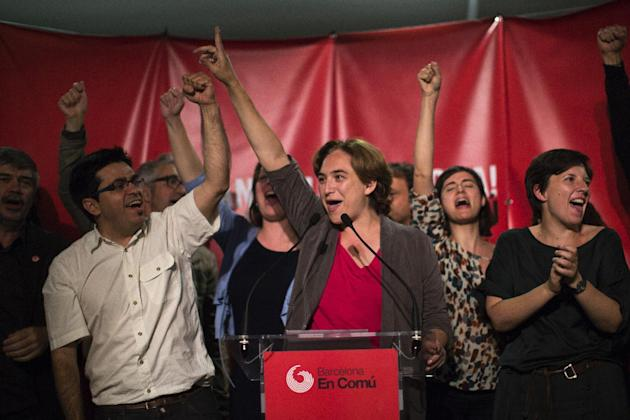 Europe And Africa Week In Pictures - FILE - In this file photo dated  Sunday, May 24, 2015, the leader of leftist coalition Barcelona Together, Ada Colau, center, celebrates the victory of her party a