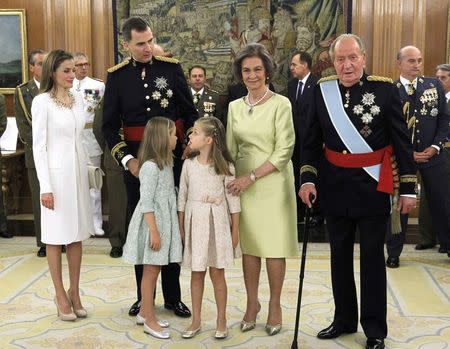 Spain's King Juan Carlos and Queen Sofia, new King Felipe VI, her wife Queen Letizia, their daughters Princess Leonor and Princess Sofia pose after the Sash of Captain-General ceremony at La Zarzuela
