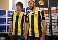 Chechen Muslim football players Gabriel Kadiev (L) and Zaur Sadayev pictured during their introduction by the Beitar Jerusalem football club to the press in Jerusalem on January 30, 2013. The torching of Beitar Jerusalem's offices by fans angry at the signing of the two Muslim players has sparked a major outcry which both supporters and ex-players hope could end decades of open racism at the club