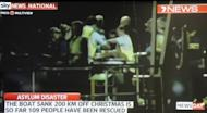 This screen grab of Channel Seven footage shown on Sky News and taken on June 22 shows survivors arriving at Christmas Island after their boat capsized 120 nautical miles north of Christmas Island on June 21. So far 109 people have been rescued from the vessel