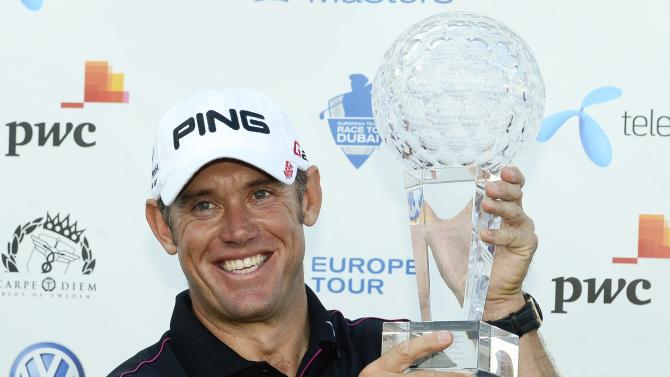 England's Lee Westwood smiles holding th