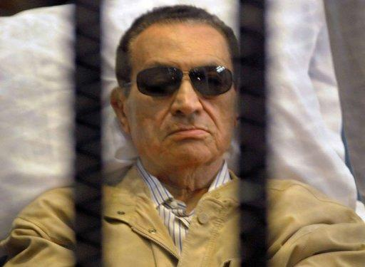 Ousted Egyptian president Hosni Mubarak sits inside a cage in a courtroom during his verdict hearing in Cairo. Mubarak was sentenced to life in prison for his involvement in the murder of protesters during the uprising that ousted him last year, enjoyed near absolute power for three decades
