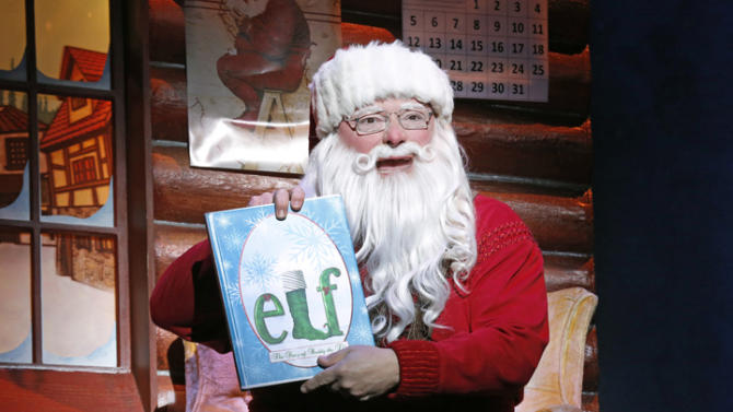 """This undated publicity photo provided by The Hartman Group shows Wayne Knight as Santa in """"Elf"""" at the Al Hirschfeld Theatre in New York. (AP Photo/The Hartman Group, Joan Marcus)"""