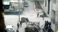 Image grab taken from a video uploaded to YouTube on April 18 shows Syrian forces with tanks monitoring the streets in Damascus. AFP is using pictures from alternative sources as it was not authorised to cover this event and is not responsible for any alterations which cannot be independently verified