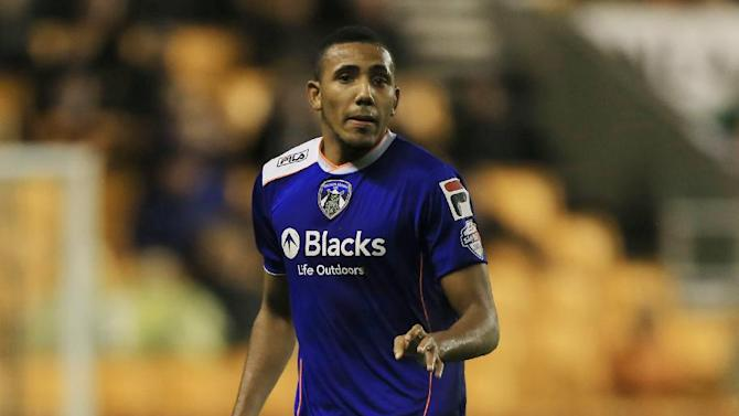 "This file photo dated Oct. 22, 2013, shows Oldham Athletic's Cristian Montano. One of the six players arrested as part of an investigation into spot-fixing in English football has been fired by his club. Third-tier Oldham says Monday Dec. 16, 2013, that Cristian Montano has been dismissed because of conduct that has brought the club and football authorities into disrepute and ""amounts to very serious breaches of club discipline."""