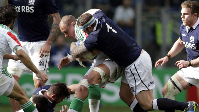 Italy's captain Sergio Parisse, left, is tackled by Scotland's Ryan Grant during a Six Nations rugby union international match between Italy and Scotland, in Rome, Saturday, Feb. 22, 2014. (AP Photo/Andrew Medichini)