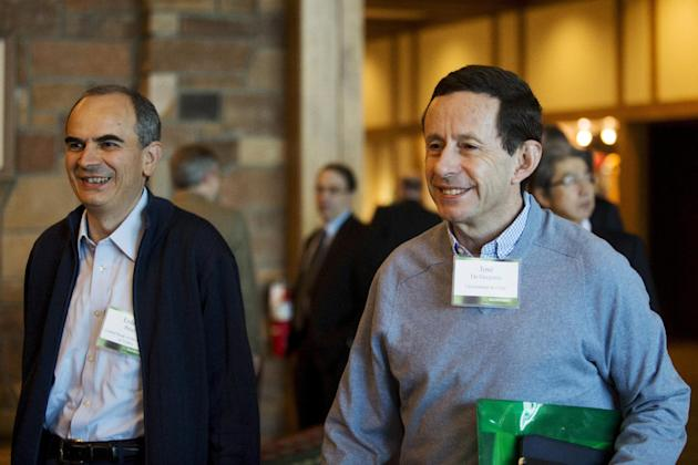 Turkey's Central Bank Governor Erdem Basci and University of Chile Professor Jose De Gregorio (R) attend the Federal Reserve Bank of Kansas City's annual Jackson Hole Economic Policy Symposium