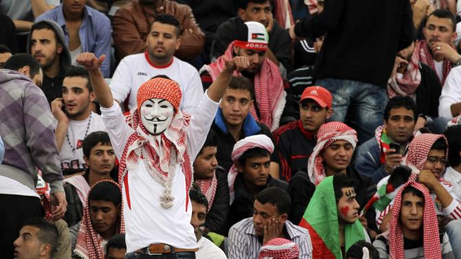 A Jordanian fan cheers for his team before their World Cup qualifying soccer match against Uruguay at Amman International stadium