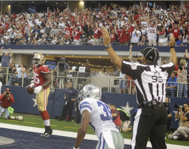 San Francisco 49ers tight end Vernon Davis (85) scores a touchdown during the first half of an NFL football game against the Dallas Cowboys Sunday, Sept. 7, 2014, in Arlington, Texas. (AP Photo/LM Ote