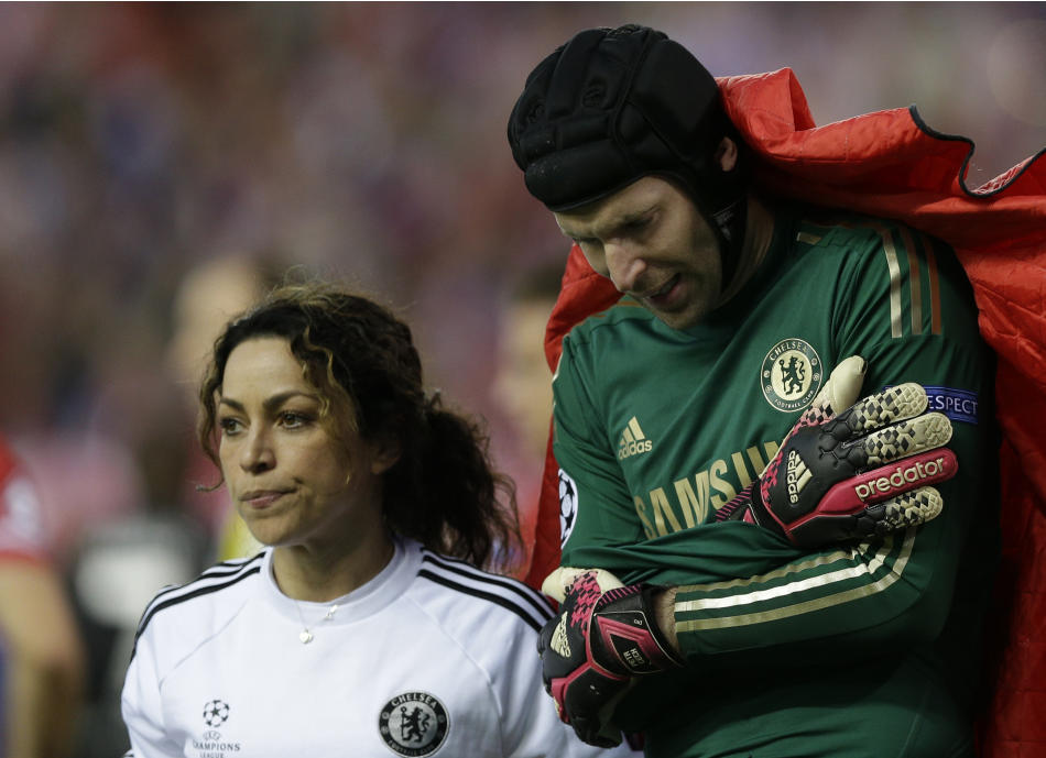 Chelsea goalkeeper Petr Cech holds his arm as he is covered by a blanket as he leaves the pitch following an injury during the Champions League semifinal first leg soccer match between Atletico Madrid
